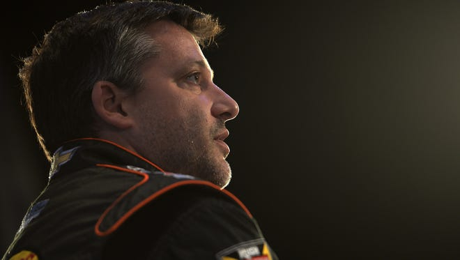 NASCAR Sprint Cup Series driver Tony Stewart speaks to the media during the 2014 NASCAR Media Day.