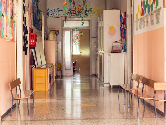 Empty hallway with no kids that leads to a kindergarten
