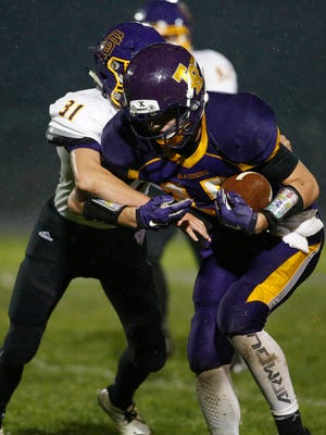Two Rivers' Kelvin Veldre (15) runs for a few extra yards against Sheboygan Falls after receiving a long pass at Two Rivers High School Friday, Oct. 13, 2017, in Two Rivers, Wis. Josh Clark/USA TODAY NETWORK-Wisconsin