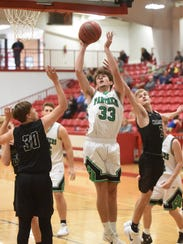 Yellville-Summit's Nash Dowden (33) goes up for two