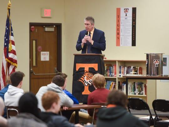 Principal Charlie Eisenreich speaks during a time capsule