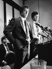 University of Miami quarterback Jim Kelly and running back Mark Rush, right, meet the press in Houston on June 9, 1983 after signing multi-year contracts with the new USFL franchise, the Gamblers.
