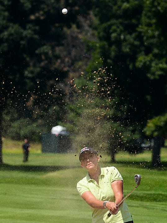 CORRECTS TO BELMONT NOT GRAND RAPIDS - Cristie Kerr watches her shot as she hits from the sand on the ninth green during the second round of the Meijer LPGA Classic golf tournament at Blythefield Country Club in Belmont, Mich., Friday, Aug. 8, 2014. (AP Photo/The Grand Rapids Press, Emily Rose Bennett) ALL LOCAL TELEVISION OUT; LOCAL TELEVISION INTERNET OUT
