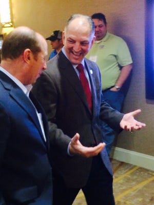 Gov. John Bel Edwards leaves Tuesday's meeting of the American Sugar Cane League in Lafayette.