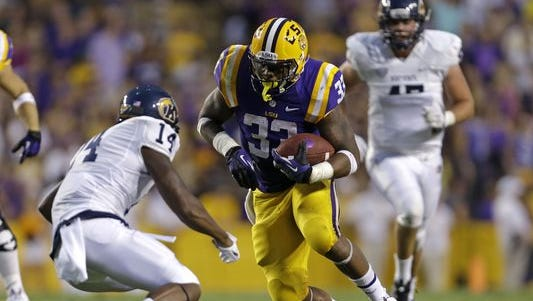 LSU running back Jeremy Hill (33) carries in the first half of an NCAA college football game against Kent State in Baton Rouge, La., Saturday, Sept. 14, 2013.