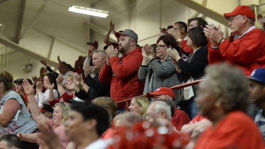 Richmond fans applaud as the Red Devils are introduced Saturday before the start of the regional final at Southport.