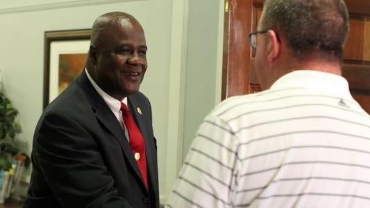 Hattiesburg Police Chief  Anthony L. Parker, left, greets City Council President Kim Bradley.