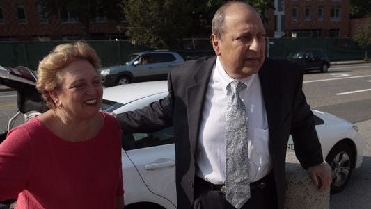 Sen. Thomas Libous arrives at the White Plains federal courthouse with his wife, Frances, for the start of jury selection.