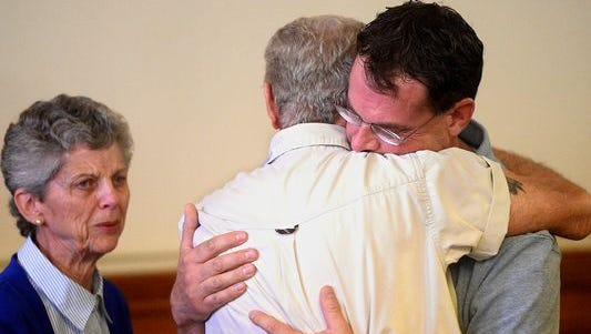 Thomas Jaraczeski hugs his father Ron after being found not guilty of deliberate homicide in the 1996 death of Geraldine Veterinarian Dr. Bryan Rein on  Wednesday afternoon in the Choteau County Courthouse.