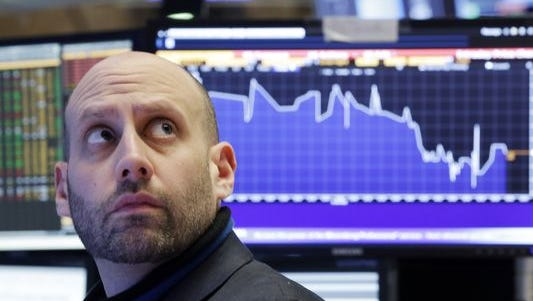 Specialist Meric Greenbaum works on the floor of the New York Stock Exchange, Tuesday, Jan. 19, 2016.