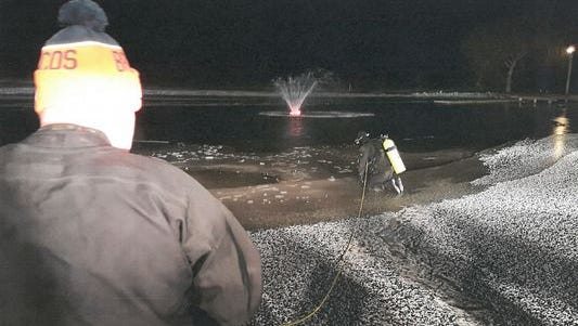 A diver gets set to enter an icy pond where an Indiana man died on Tuesday.