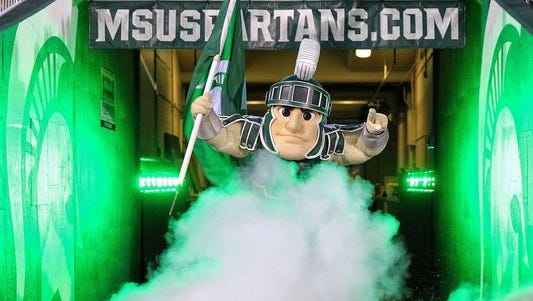 Michigan State Spartans mascot Sparty enters the stadium prior to a game at Spartan Stadium.