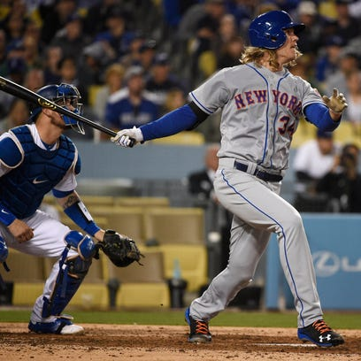 New York Mets starting pitcher Noah Syndergaard (34) hits a three-run home run against the Los Angeles Dodgers during the fifth inning at Dodger Stadium.