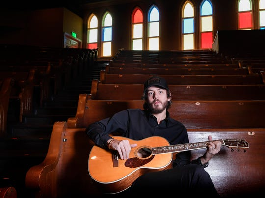 American singer songwriter Chris Janson plays as he poses for a portrait at the Ryman Theater in Nashville, Tenn., Tuesday, Jan. 23, 2018.