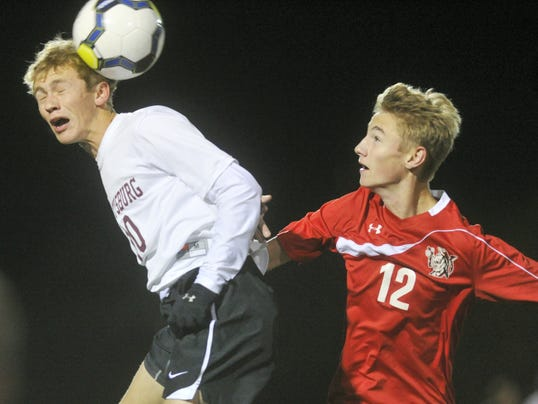 Gettysburg's Adam Yingling, left, and Susquehannock's Colton Mumley battle for a head ball during Gettysburg's 3-0 victory in the District 3 Class AA soccer tournament semifinals at Northeastern on Monday. Gettysburg advances to Thursday's championship game against Lancaster Mennonite, the second straight title appearance for the Warriors.