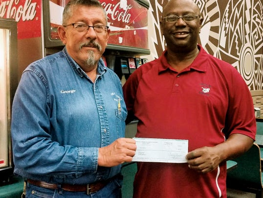 Submitted Photo Leading Knight George Torres, left, of the Deming Elks Lodge 2750 presented Silas Wilson with a check for 400 to help with his summer youth league in Deming.