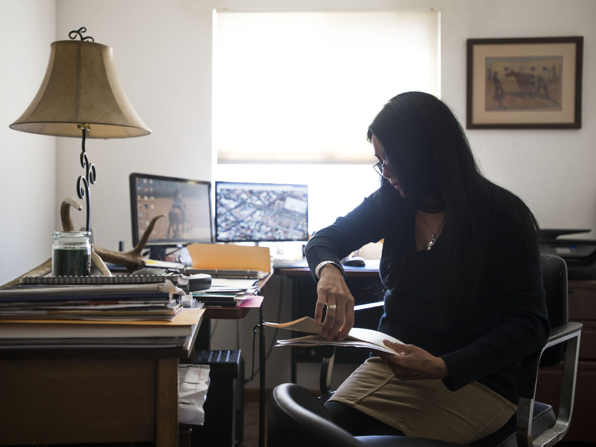 Lydia Lerma, the mother of the first victim who came forward in a child sexual assault case against Andrew Vanderwal, digs through documents and evidence on April 10, 2018, in the home office at her home in Fort Collins, Colorado. Lerma had collected the evidence during her hunt for Vanderwal.