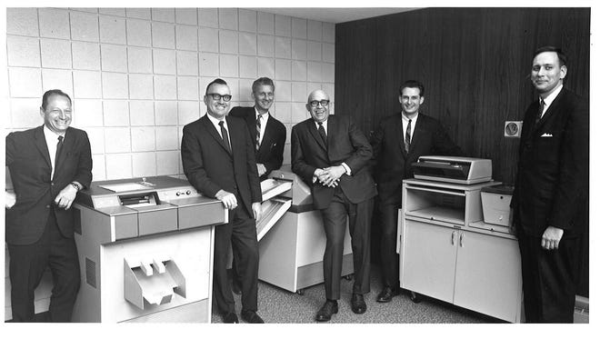 E.O. Johnson, second from left, with employees in the 1950s.