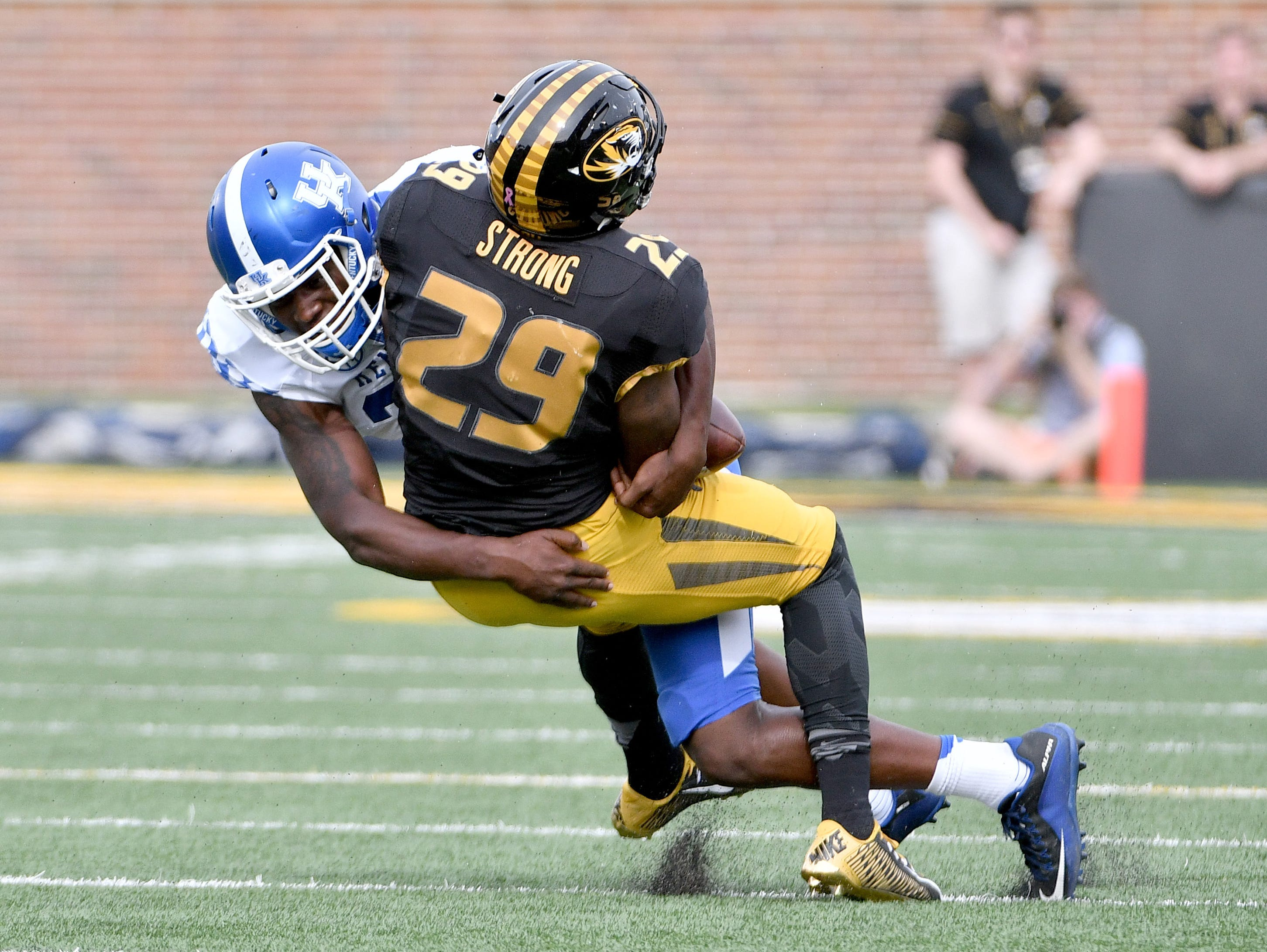 Oct 29, 2016; Columbia, MO, USA; Missouri Tigers running back Nate Strong (29) is tackled by Kentucky Wildcats linebacker Eli Brown (32) during the second half at Faurot Field. Kentucky won 35-21.