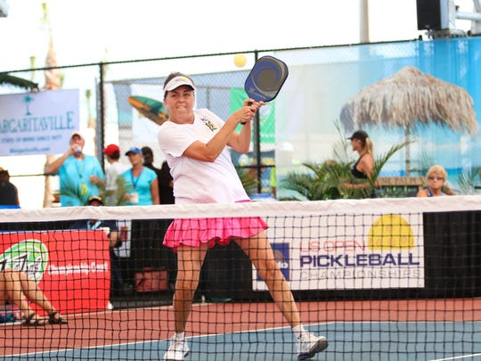 Donna Curry returns the ball during the women's 45-and-over doubles final at the U.S. Open Pickleball Championships at East Naples Community Park on April 24, 2017.