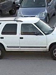 Police are asking for the public's help in identifying a man who was spotted as a passenger in a white SUV, at Larry J. Macaluso Elementary School on Nov. 17.