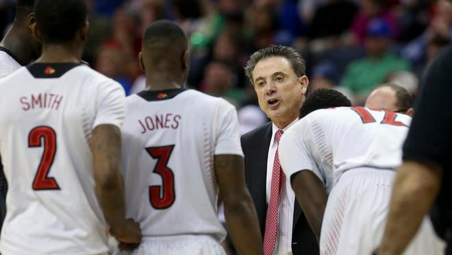 U of L head coach Rick Pitino instructs his players during the AAC Tournament Championship at the FedExForum in Memphis on Saturday.