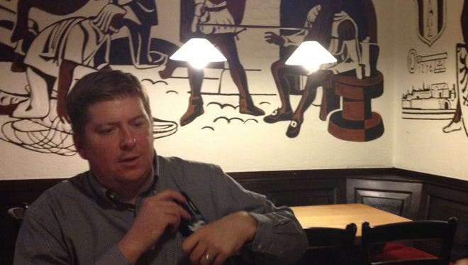 MSU beat writer Joe Rexrode relaxes after a long day of reporting on MSU basketball in Kaiserslautern, Germany in 2012.