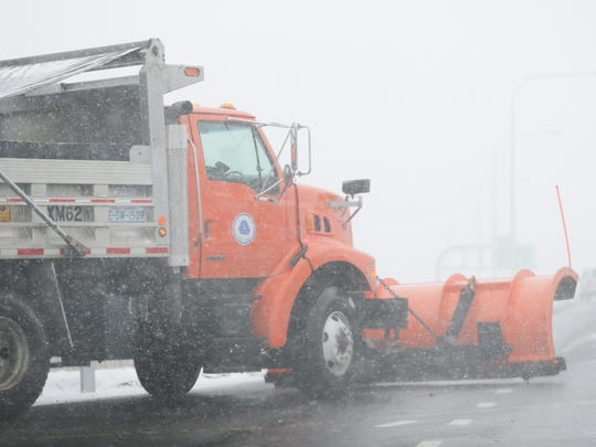 In this file photo, A Delaware Department of Transportation snowplow drives down Route 141 N during a snow storm.