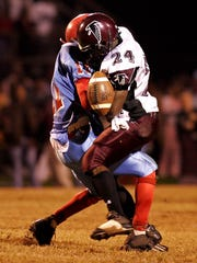 Austin-East's Anthony Anderson (11) is hit by Dennis