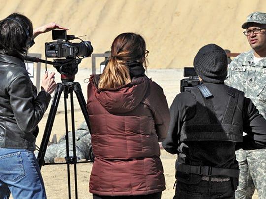 Dena Seidel, Rachel Kurzynowski, Steve Holloway film Wally Batista at Fort Dix firing range.