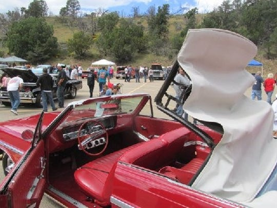 As rain clouds roll in, up goes the top on the hottest drive-in date car in the Aspenfest Rod Run and Car Show.