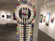 A sculpture made of paint brushes is on display at