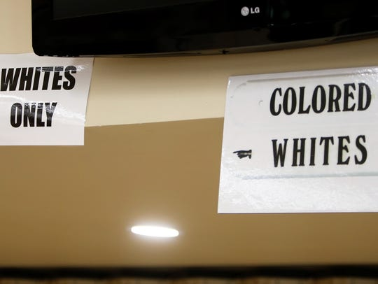 Signs hung in St. Mary's Kitchen on the San Juan College