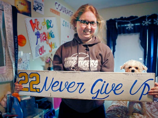 In this Dec. 8, 2014, file photo, Lauren Hill holds