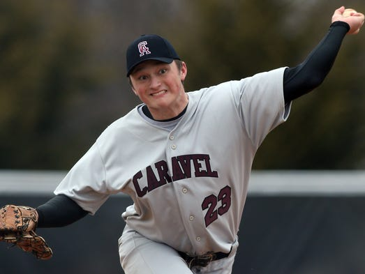 Caravel starter Cory Hart delivers in the first inning of Caravel's 10-0, 5 inning win against Cape Henlopen in the spring opener for both teams, Saturday, March 22, 2014.