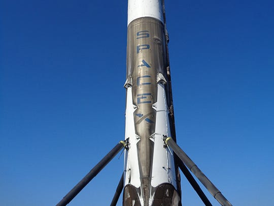 A SpaceX Falcon 9 booster after landing on a ship in