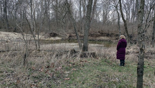 Liberty Township resident Michaux Merhout in Cherokee Park, near where she said bullets passed by her 13-year-old daughter's head in January.