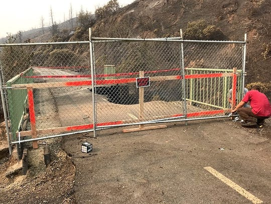 Chain-link fencing is installed on a section of the