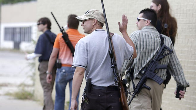 Gun-rights advocates take part in a Sept. 21, 2014, protest of the arrest of 24-year-old Elijah Woody, in Detroit.