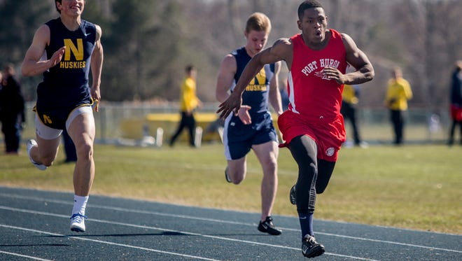 Port Huron senior Jermaine Drake, 17, leads in the 100-meter dash during a track meet Thursday, April 14, 2016 at Port Huron Northern High School.