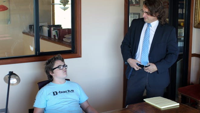 Joshua Brown, left, speaks Monday alongside Redding attorney Ryan Birss. Joshua, 13, and his parents received a cease and desist letter from Rep. Doug LaMalfa's office in August over the familiy's alleged repeated contacts to the office.