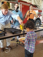 This young boy is happy to be among the first recipients of a pancake breakfast to honor first responders for their brave and courageous work in wildfire control.