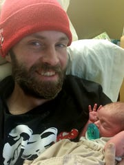 "In this undated image, 33-year-old Corey ""Daniel"" Brooks Goodrum, holds his newborn son, Ryder, four weeks prior to his death from a drug overdose. His girlfriend, Haley High, 28, was accused of supplying the heroin that killed the father of three. High is charged with second-degree murder in his February 2016 death."