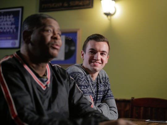Evan Leedy, 19, of Macomb Twp. listens while James Robertson 56 of Detroit is recorded for CBS after meeting for the first time at Mr. B's Pub in Rochester on Monday February 2, 2015 following starting a funding campaign after reading the Detroit Free Press story of Robertson's dedication and journey to and from work each day.