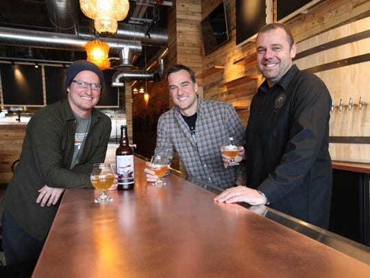 Jolly Pumpkin Pizzeria & Brewery cofounders Jon Carlson, left, Greg Lobdell and Tony Grant, CFO/COO of Northern United Brewing Co., in the tasting room of the restaurant in Midtown. The restaurant, set to open April 11, will feature creative pizzas, sandwiches and salads.