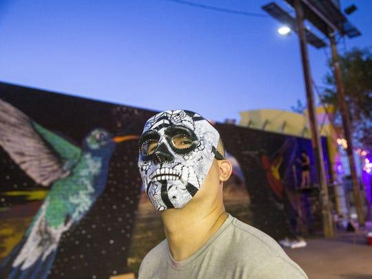 Muralist Lalo Cota is one of several Phoenix artists