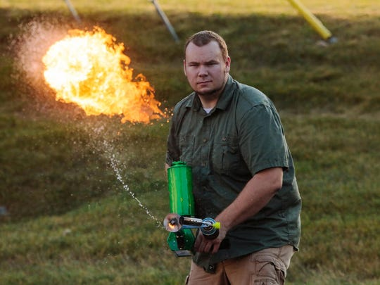 Chris Byars, project leader for the Ion Productions Team, demonstrates the XM42, which he dubs the world's first commercially available handheld flamethrower.