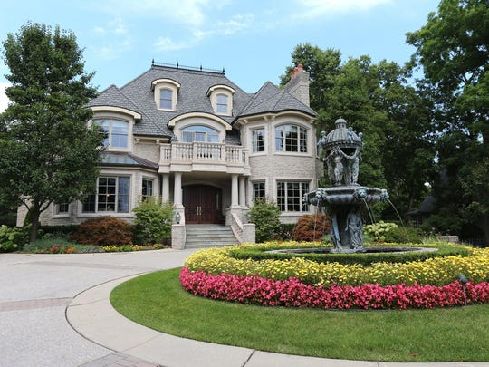 The custom West Bloomfield estate sits on more than an acre and has a private dock on Pine Lake.