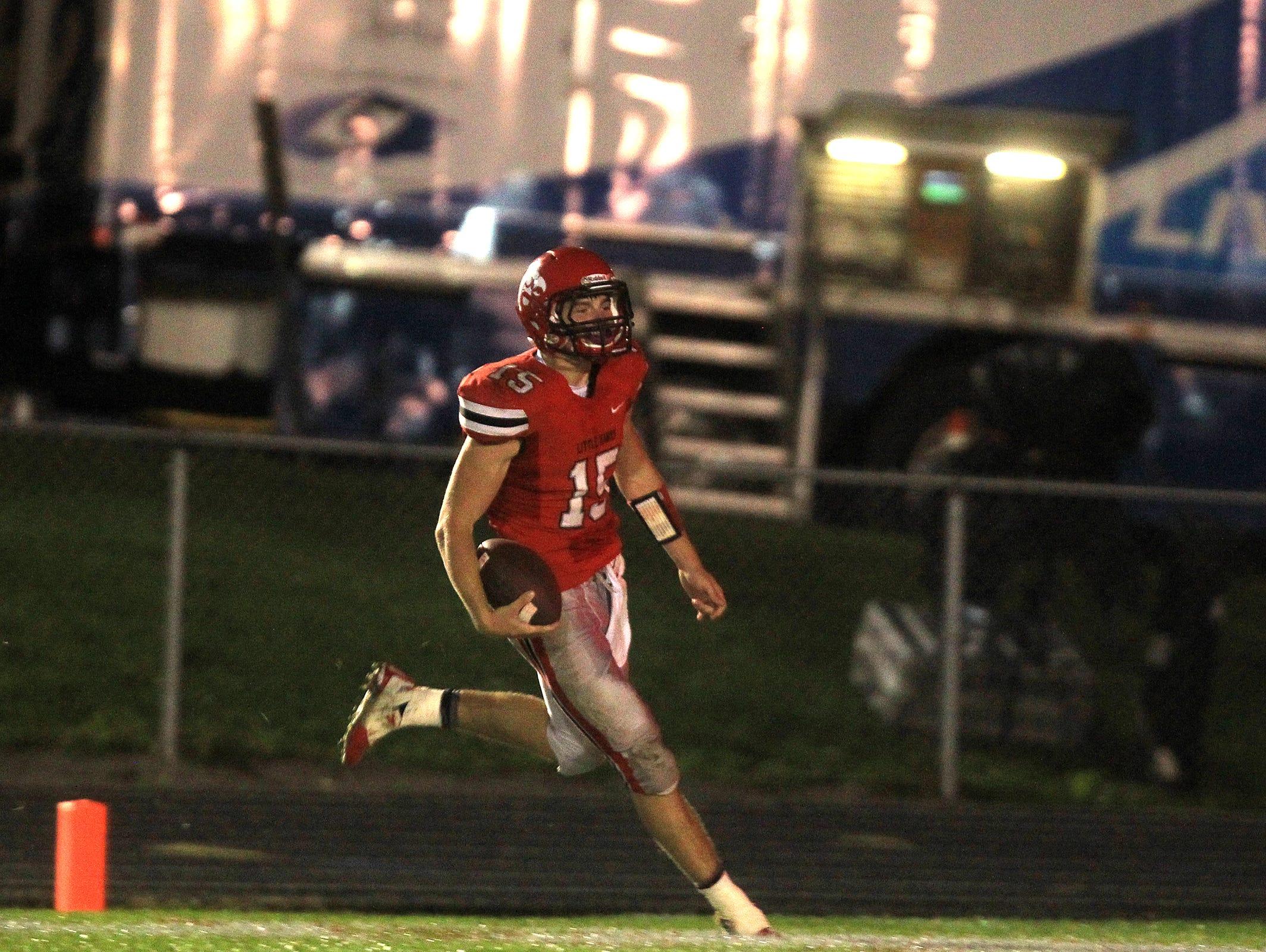 City High quarterback Nate Wieland runs in for a 57-yard touchdown during the Little Hawks' game against Cedar Rapids Prairie at City High on Thursday, Oct. 2, 2014. David Scrivner / Iowa City Press-Citizen