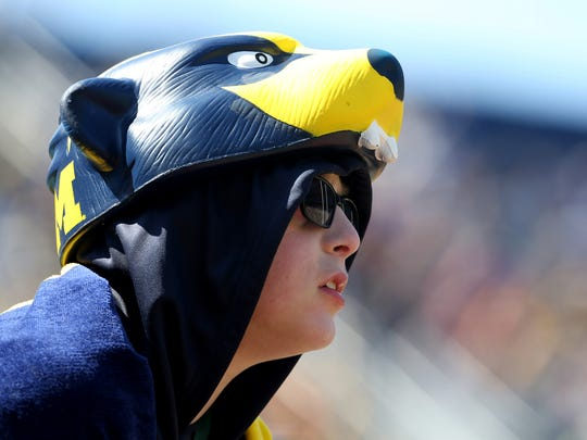 Michigan fan Mark Beesley, 12, of Taylor watches the Michigan spring football game at Michigan Stadium in Ann Arbor on April 4, 2015.